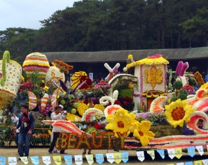 The multi-colored floral floats displayed at the athletic bowl.